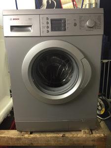refurbished silver washing machine